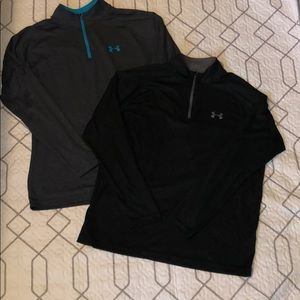 Two Men's Under Armour heat gear long sleeve tops